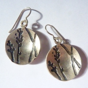 Domed and oxidised silver drop earrings.